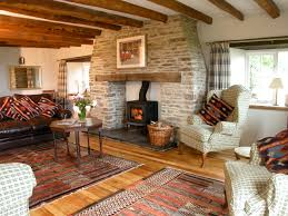 lovely cosy living rooms all cottages have an open fire or a log