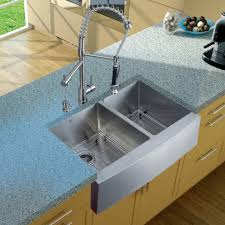 interior design white apron sink with graff faucets and white jsi