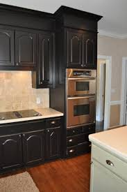 kitchen black kitchen cabinets with brown granite countertops and