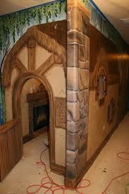 artistic murals cottage in an enchanted forest with wizard tree