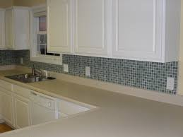 decorating beige countertop and glass backsplash ideas in simple