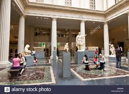visitors to the metropolitan museum of art sitting on benches in