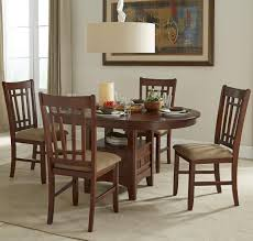 oval dining table set with cushioned side chairs by intercon