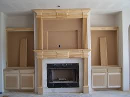 decorating oak wood fireplace mantel kits plus nice book case and
