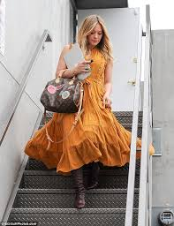 All about the accessories  She tied the elements of her outfit together with a large