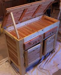 pallet wood storage cabinet made from pallet wood cut into strips