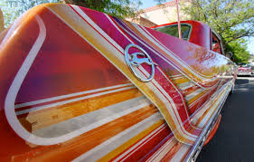 This May          photo shows the stylized quarter panel of a      Chevrolet Impala