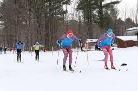 Two Nakkertok juniors     Faster Skier