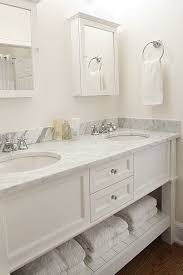 Pottery Barn Bathroom Storage by Traditional Master Bathroom With Wood Floor U0026 Marble Counter
