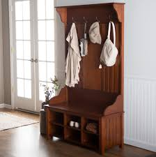 Storage Bench With Hooks by Brown Wooden Bench Connected With Four Storage Under The Seat