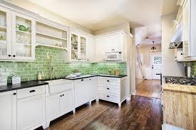 white cabinetry marble countertops and brick tile backsplash unify full size of white kitchenware white kitchen appliances white kitchens green tile backsplash hardwood flooring ideas
