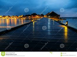 water bungalows houses at night tropical landscape stock photo