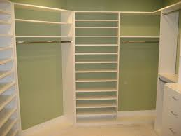 white painted oak wood corner closet shelving with top shelves and
