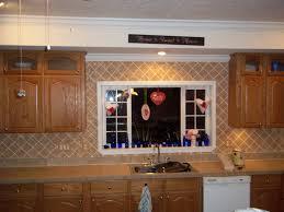 travertine subway tile kitchen backsplash with a mosaic glass