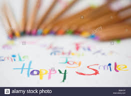 Paper With Writing Coloured Smile Happy Joy Fun Words On Paper With Colouring