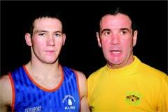 Boxer William McLaughlin pictured with his coach Stephen Friel. - BoxerPic