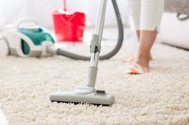suction grey carpet cleaning with vacuum cleaner stock photo