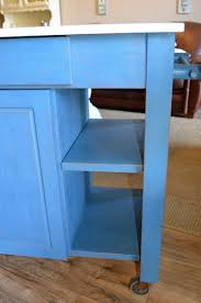 distressed blue kitchen island on wheels the workshop distressed blue kitchen island on wheels