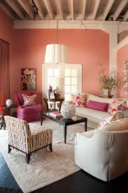 living room rosy stained wall colorful cushions pink armchair