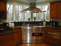 Kitchen Peninsula With Seating by Corner Range With A Chimney Hood Windows Home Kitchen
