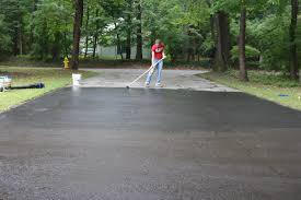 how to fix cracks in a driveway and apply a coat of sealant how