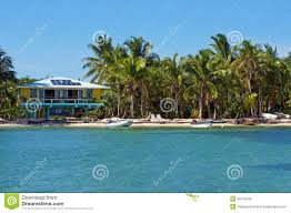 tropical seashore with beach house royalty free stock photos