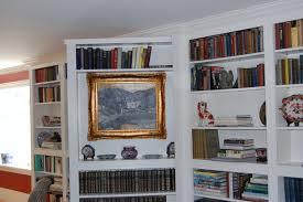 cool white interior design with hidden bookcase door room and dark