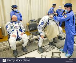 expedition 43 nasa astronaut scott kelly left watches as russian