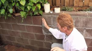 repair a structural in cinder block wall just an