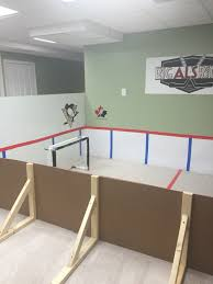 mini knee hockey rink made by mom using poster board and vinyl