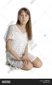 beautiful teen in white transparent dress isolated stock