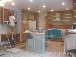 How To Clean Painted Kitchen Cabinets The Thrifty Home Kitchen Remodel Painting Cabinets