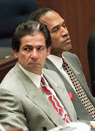 Robert Kardashian sits with