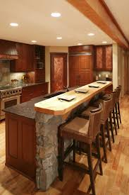 island comprised of stone wall and rich wood paneling matching the