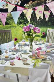 easter party decorations with outdoor area and flowers and table