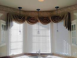 swag curtain valance over wood blinds swag curtains pinterest