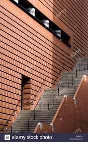 staircase along side red brick wall of san francisco museum of