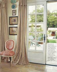 ticking curtains and gorgeous french doors dining room