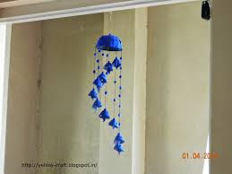 can you believe that this wind chime is made with waste egg carton