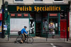 Polish workers in UK worry about possibility of Brexit   Daily     Daily Mail A man cycles past a Polish Specialities shop in London  Tuesday  April