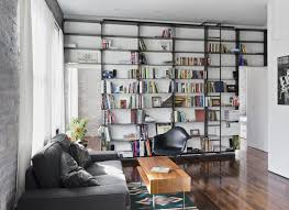 handmade minimal blackened steel bookshelves with rolling library