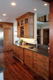 cherry kitchen cabinets with white countertops wood floorsk
