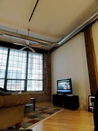 How To Decorate Your New Home by Inspiring Small Living Room With Industrial Style And Ceiling Fan