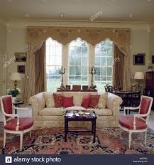 Country Living Room Curtains Cream Sofa In Front Of Window With Ornate Pelmet And Cream