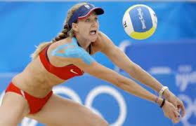 2008 Gold Medal winner Kerri Walsh supports her shoulder with kinesio taping.