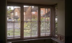 replace your windows treatments with wooden venetian blinds