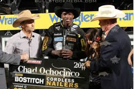 Chad Ochocinco has a grin from ear to ear after collecting 10,000 for riding a bull for 1.5 seconds.