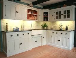 white wooden cabinet and kitchen island with plus brown wooden