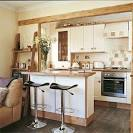 Open-plan country style kitchen-living room with breakfast bar ...