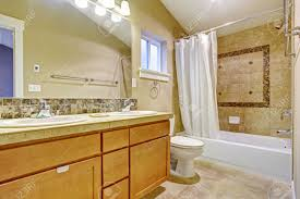 beige tone bathroom interior with tile wall trim vanity cabinet